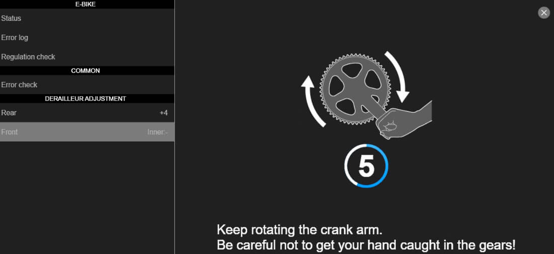 Adjust your front derailleur turn the cranks